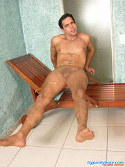 Muscle guy sniffing his lacy pantyhose before wearing them for jerking off